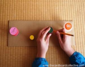 Cardboard and Cap Peg Rack Craft