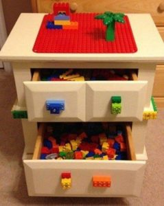 Bedside table modifies into a Lego desk